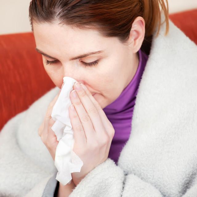 """woman sneezing in the handkerchief"" stock image"