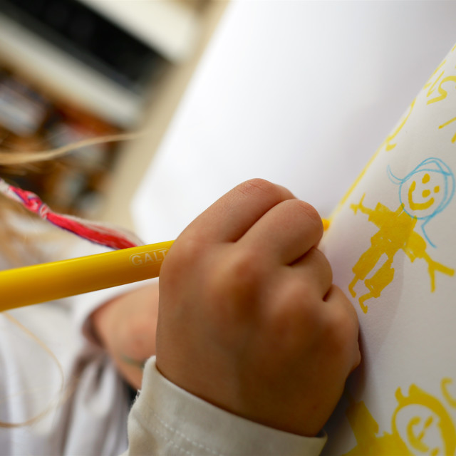 """Child/Girl Drawing Picture for Mother's Day"" stock image"