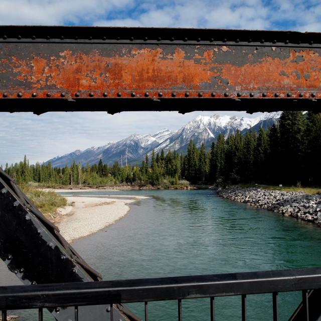 """""""railroad bridge view of canadian rockies"""" stock image"""