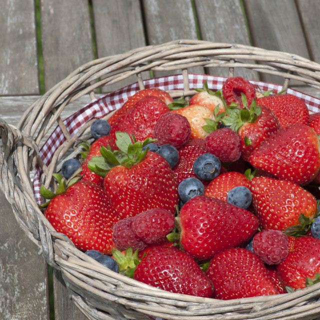"""Strawberries, blueberries, raspberries Mix in the basket"" stock image"