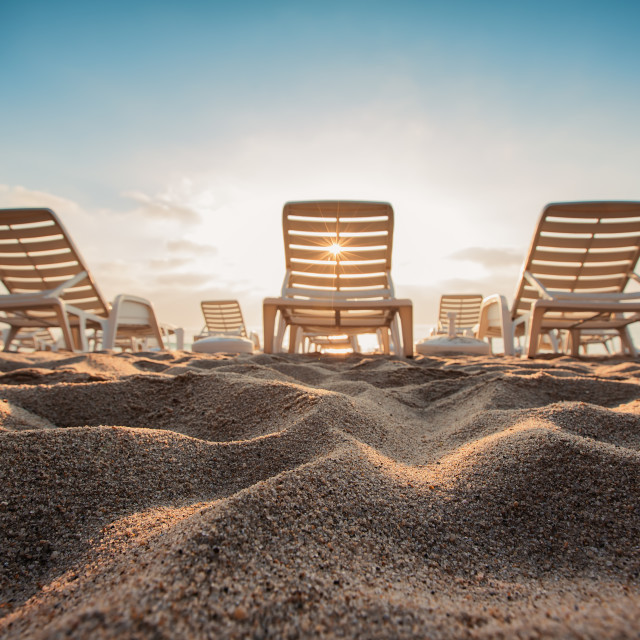 """Beach chairs on the exotic tropical beach, sunrise shot"" stock image"