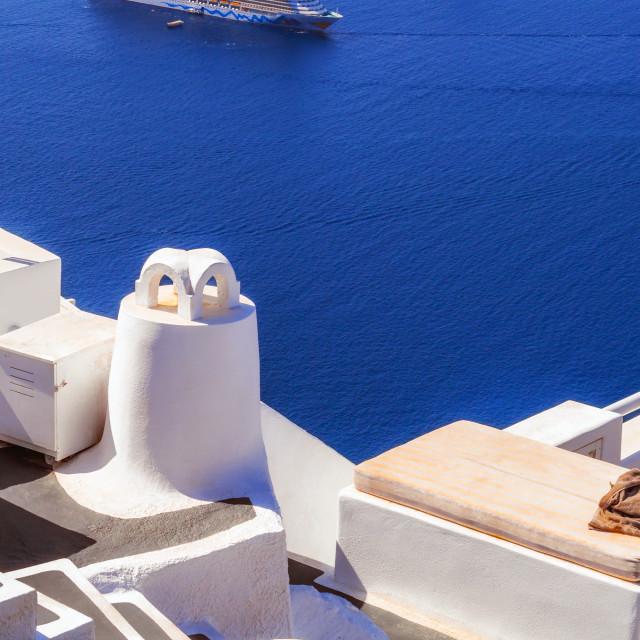 """Imerovigli village architecture overlooking the cruise ships in the caldera, Santorini island, Greece"" stock image"