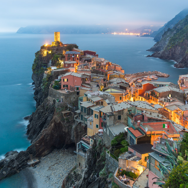 """Illuminated at night the town on the rocks Liguria Italy"" stock image"