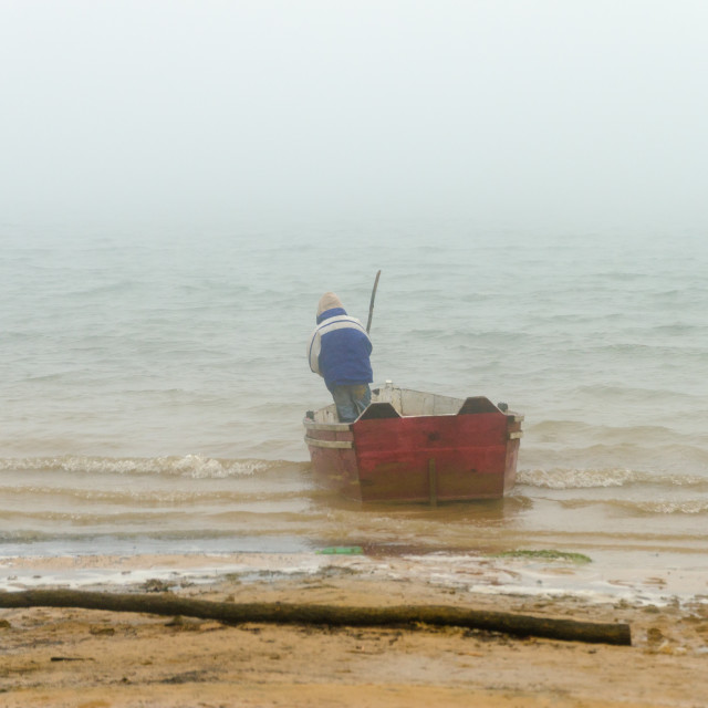 """Canoe in Bad Weather"" stock image"