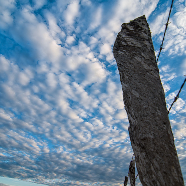 """""""Fence Post and Dramatic Sky"""" stock image"""