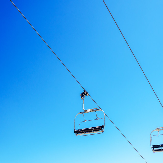 """Chairlift and Sky"" stock image"