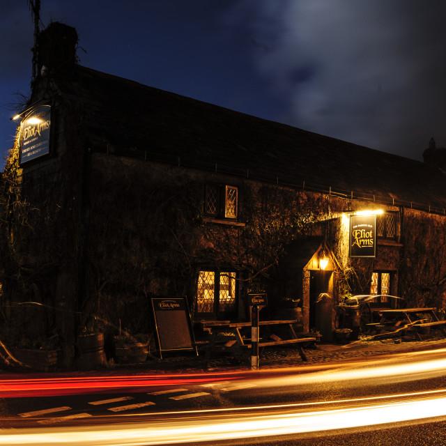 """The Eliot Arms at Tregadillett near Launceston, Cornwall at night"" stock image"