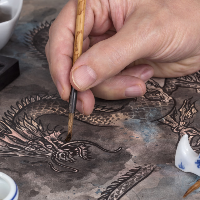 """Artist painting a Chinese dragon"" stock image"