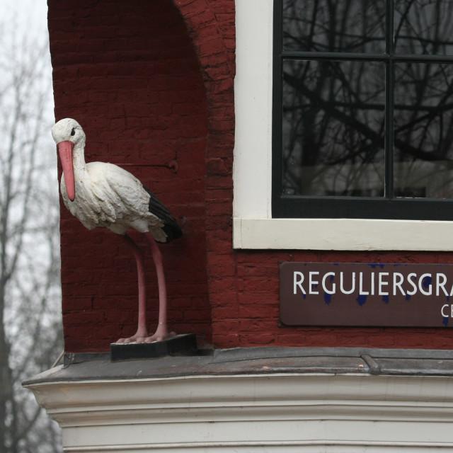"""""""Statue of White Stork in Amsterdam, Gevelbeeld Ooievaar in Amsterdam"""" stock image"""