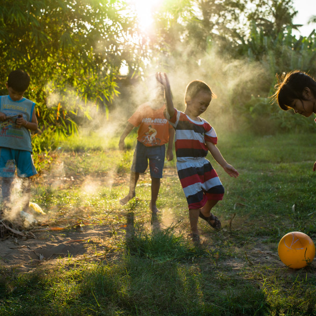 """""""Playing in the garden"""" stock image"""