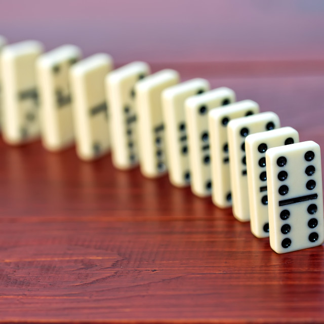 """Dominoes on a wooden background"" stock image"