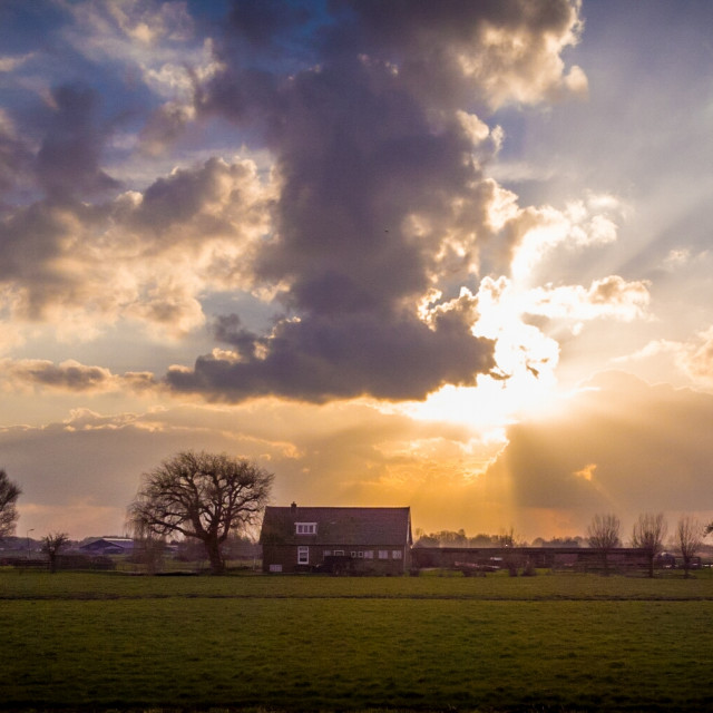 """Farmhouse at sunset"" stock image"