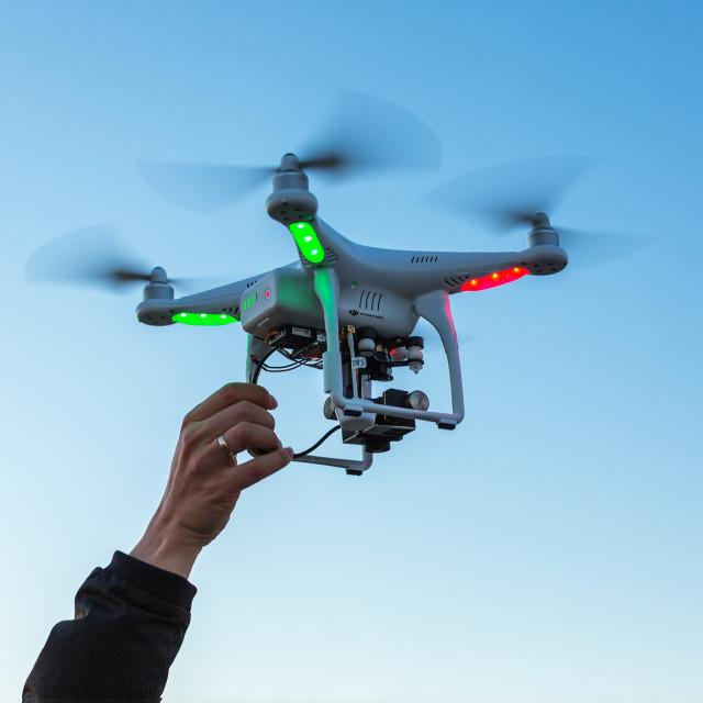 """Varna, Bulgaria - July 23 ,2015: Flying drone quadcopter Dji Phantom 2 with..."" stock image"