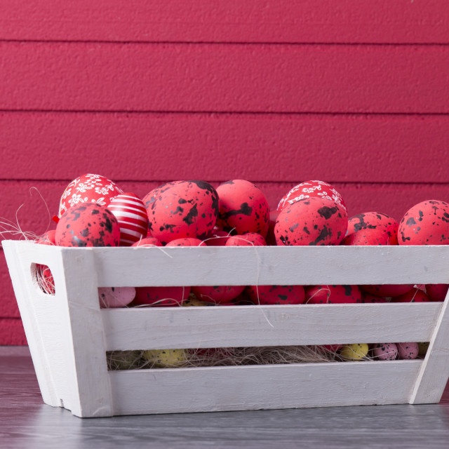 """Red Easter eggs in a wooden container"" stock image"