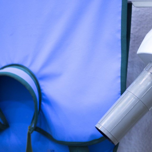 """Dentist's xray machine radiation vest"" stock image"