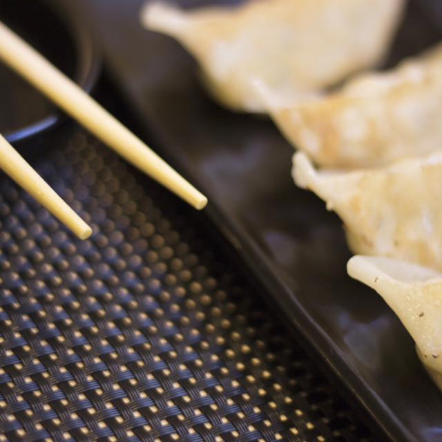 """Japanese restaurant sushi gyoza chopsticks"" stock image"