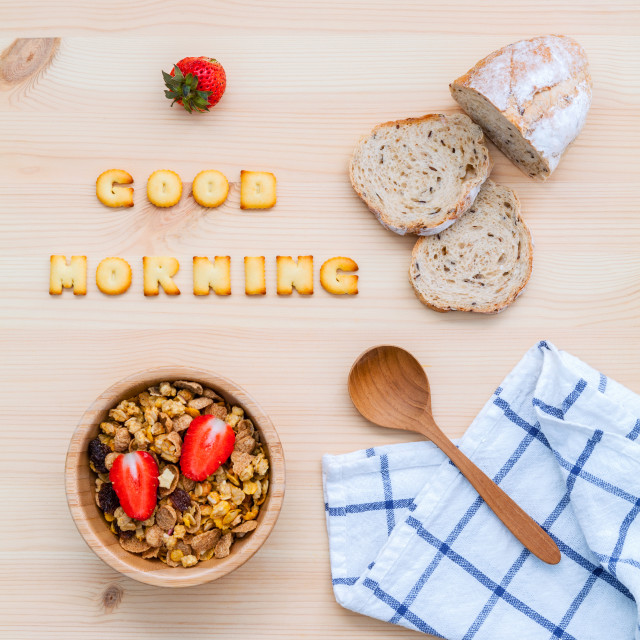 """Good morning concept - Cereal in wooden bowl with strawberry and wooden spoon..."" stock image"