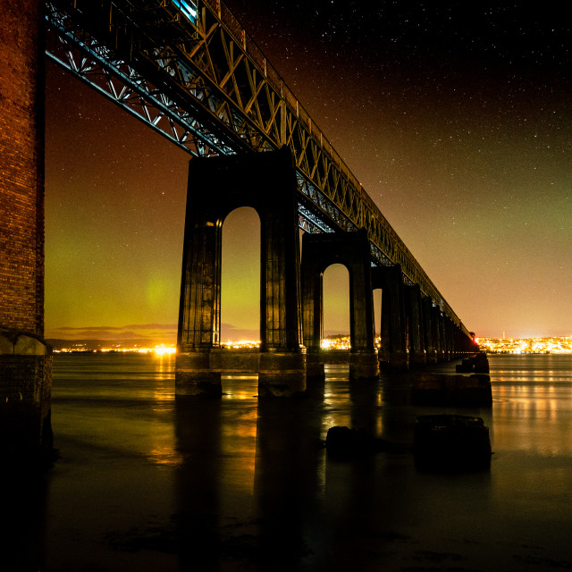"""""""Columns of the Tay Rail Bridge Looking to Dundee with the Aurora overhead"""" stock image"""