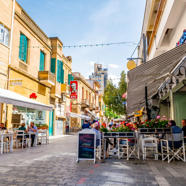 """People enjoying a summer in cafes at Onasagorou street in central Nicosia, Cyprus."" stock image"