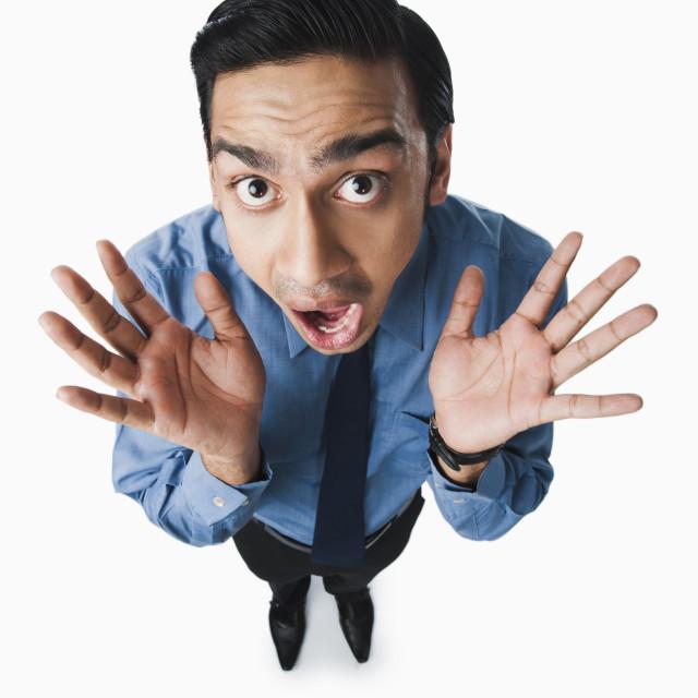 """Bengali businessman looking terrified"" stock image"
