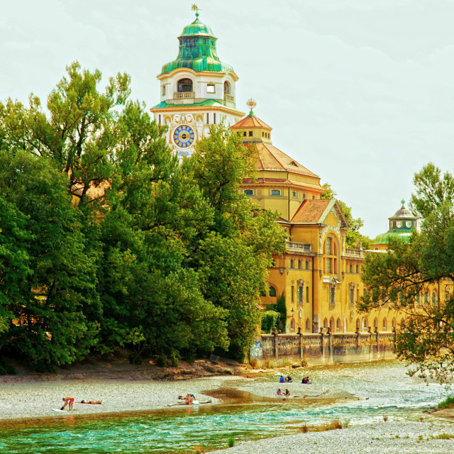 """""""Munich, people sunbathing on Isar river banks in city center"""" stock image"""
