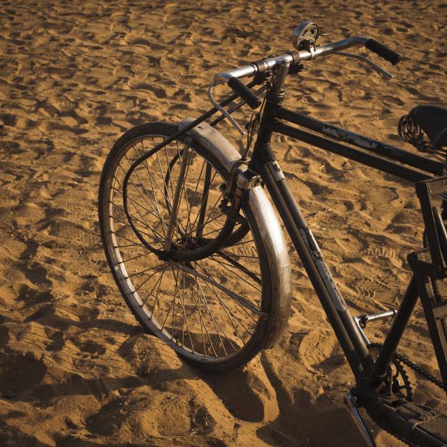 """Cycle rickshaw on sand, Pushkar, Ajmer, Rajasthan, India"" stock image"