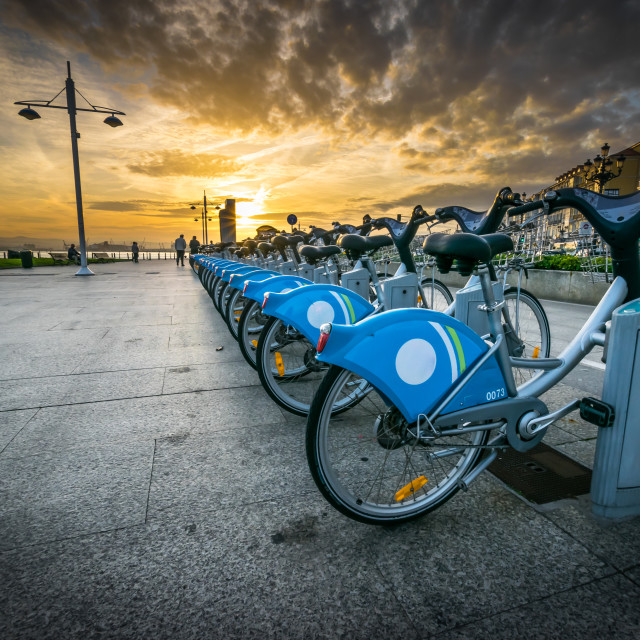 """""""Row of bicycles parked at sunset"""" stock image"""