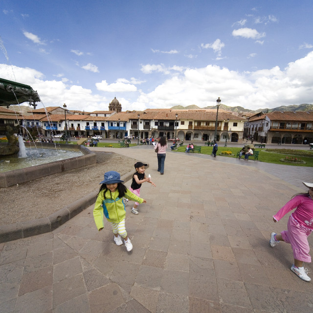 """""""PLAYING AT THE FOUNTAIN IN CUZCO"""" stock image"""