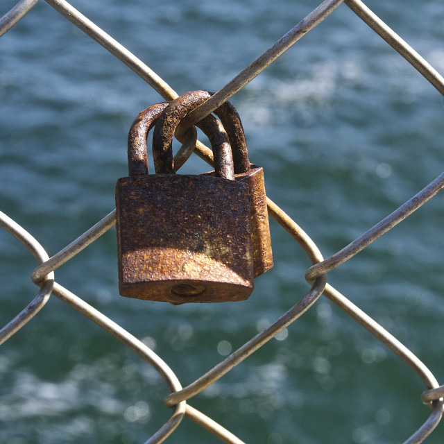 """Rusty old love locks"" stock image"