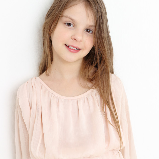 """""""Trendy little girl as a fashion model"""" stock image"""