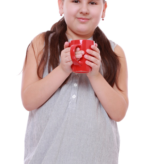 """pretty little girl with tea cup isolated over white background"" stock image"
