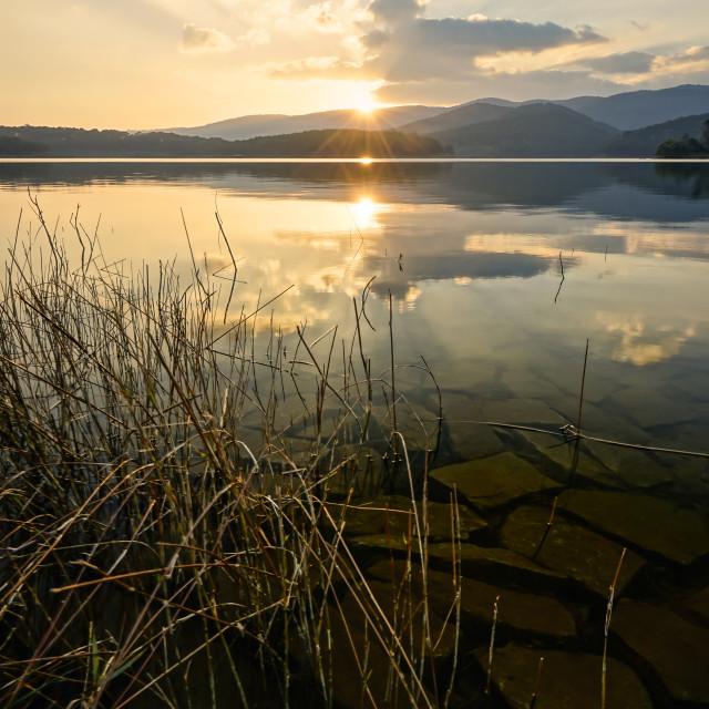 """""""Reflection of sunset"""" stock image"""