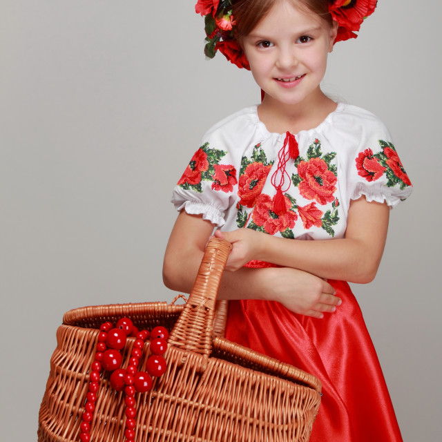 """Studio image of a happy cute youngest girls in the beautiful Ukrainian..."" stock image"
