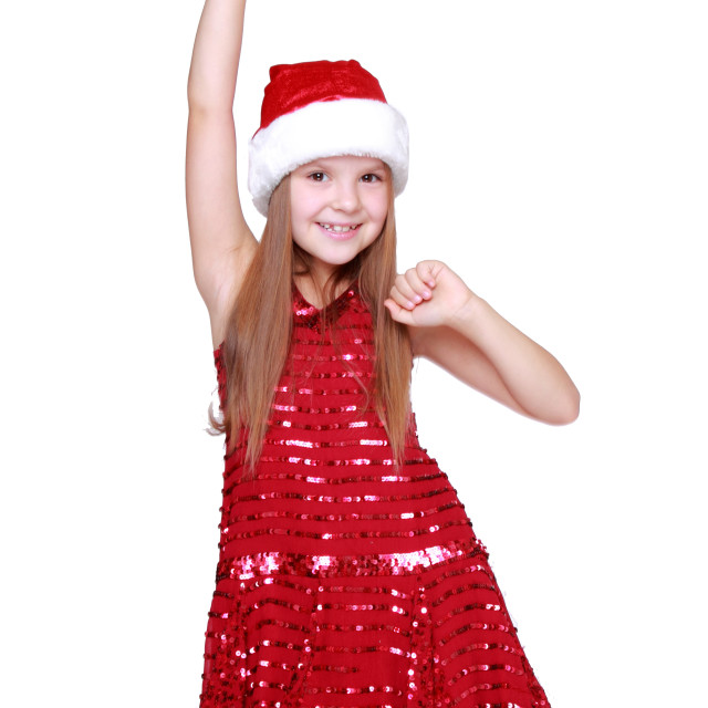"""Pretty little girl in a beautiful dress/Elegant young girl dancing on Christmas"" stock image"