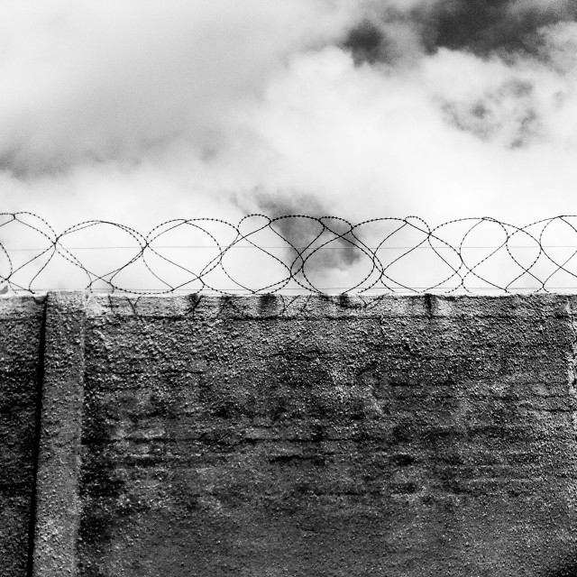"""Barbed Prison Walls"" stock image"