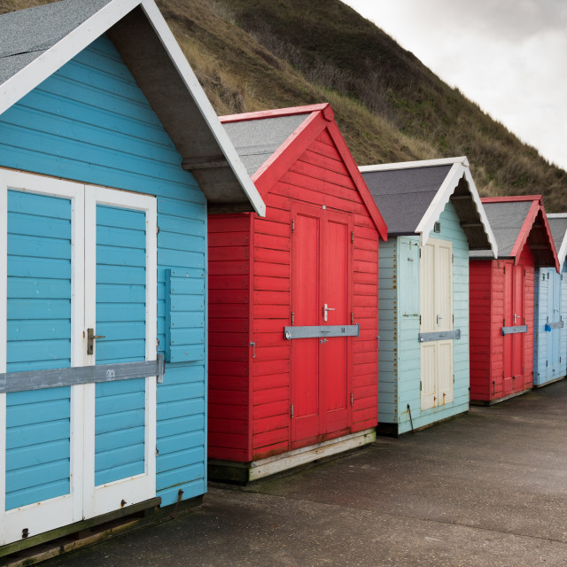 """Row of beach huts at Sheringham"" stock image"