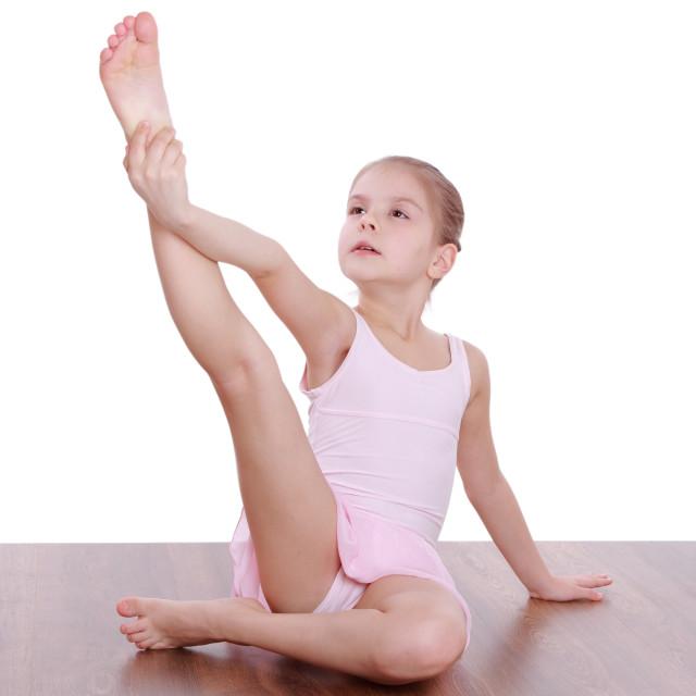 Young gymnast stretching leotard photos
