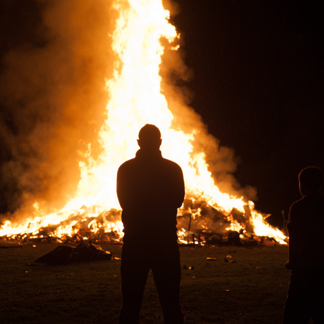 """""""Silhouette of man in front of bonfire"""" stock image"""