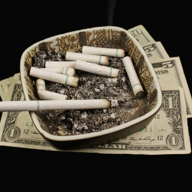 """""""Cigarettes and money."""" stock image"""