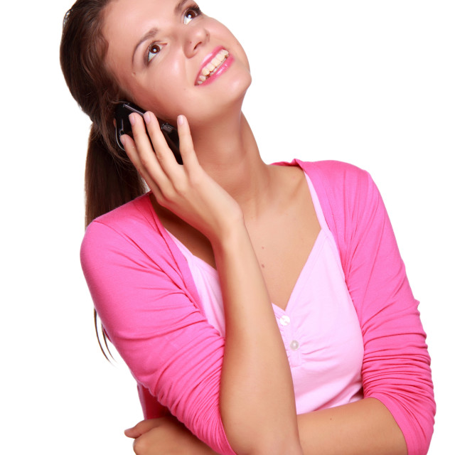 """Lovely girl talking on the phone on white background"" stock image"