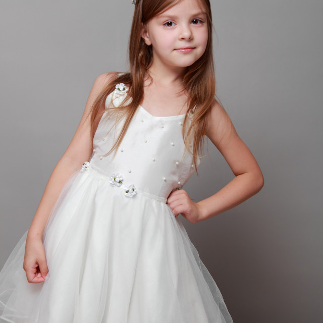 """European cute young girl wearing a crown and a white dress with a cute smile..."" stock image"