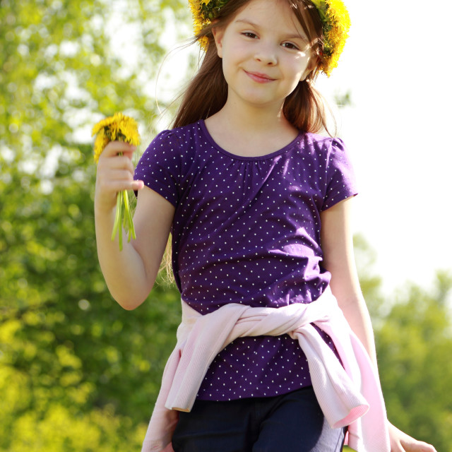 """""""Sweet little girl with floral head wreath at the spring park, moscow, russia"""" stock image"""