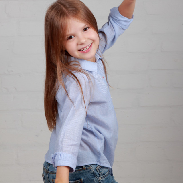 """""""Image of a happy cheerful little girl with a charming smile in casual dancing..."""" stock image"""