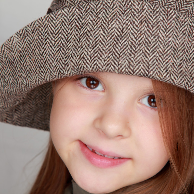 """""""Charming brown hair little girl in a beautiful autumn stylish hat"""" stock image"""
