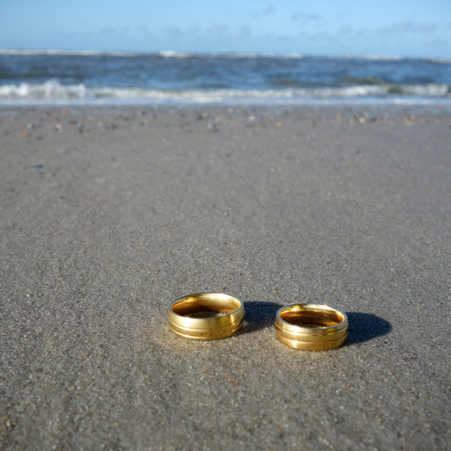 """""""Wedding rings at the beach"""" stock image"""