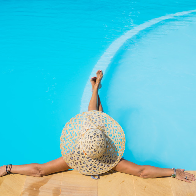 """A girl is relaxing in a swimming pool"" stock image"
