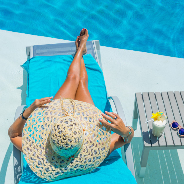 """""""Pretty blond woman a cocktail in a swimming pool"""" stock image"""