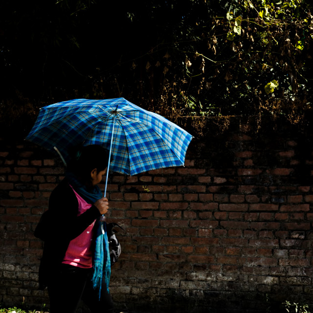 """""""Lady With The Blue Umbrella"""" stock image"""