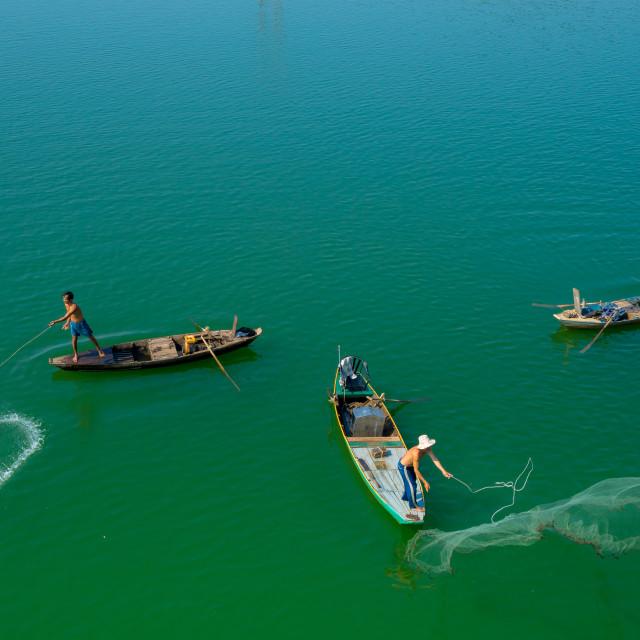 """""""Throwing fishing net at the lake"""" stock image"""