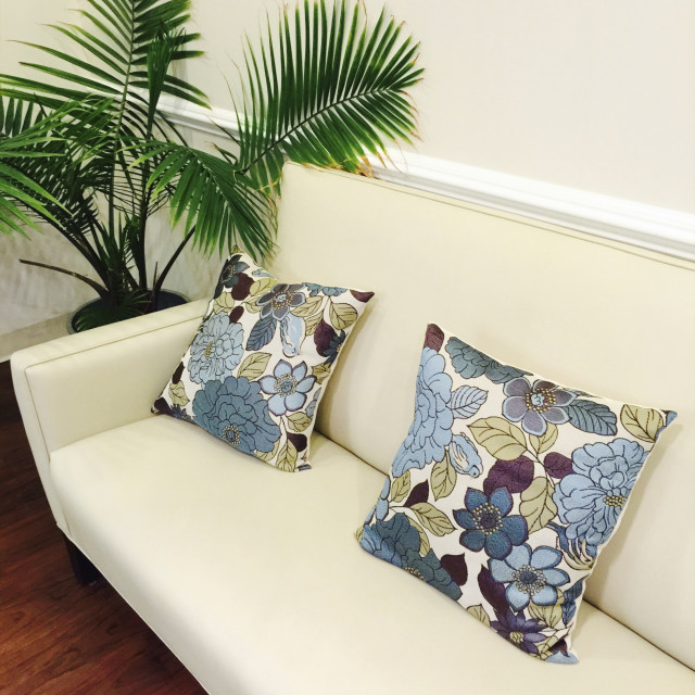 """Waiting room with colorful cushions on cough, interior."" stock image"